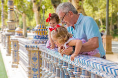 Grandparents and kids play outside Plaza Espana royalty free stock images