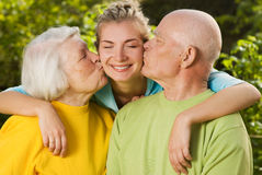 Grandparents kissing their granddaughter Royalty Free Stock Images