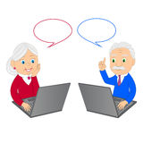 Grandparents and laptop Stock Images