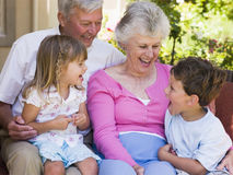 Grandparents laughing with grandchildren Royalty Free Stock Image