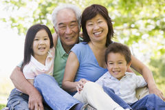 Grandparents laughing with grandchildren stock photo