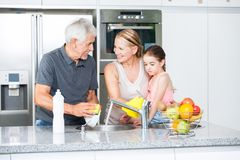 Grandparents and little girl washing dishes Royalty Free Stock Photography
