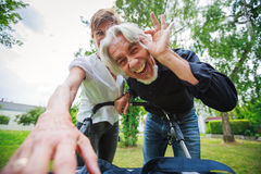 Grandparents Looking At Their Grandchild. In baby stroller, POV Royalty Free Stock Image