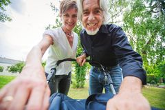 Grandparents Looking At Their Grandchild. In baby stroller, POV Stock Photos