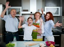 Grandparents, parents and children baking in the kitchen Stock Photography