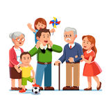 Grandparents, parents, children standing together. Grandparents, young parents and children standing together. Little daughter sitting on father shoulders Stock Images