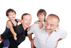 Grandparents piggybacking two boys Royalty Free Stock Photos