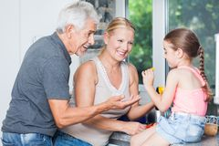 Grandparents play with little girl granddaughter Stock Image