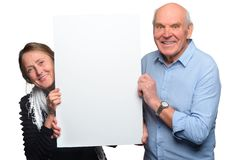 Grandparents pose with empty placard royalty free stock photos