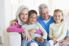 Grandparents posing with grandchildren Stock Images