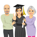 Grandparents proud and happy of granddaughter holding diploma on graduation ceremony day Stock Image