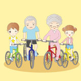 Grandparents ride bicycle with grandchildren Stock Photos