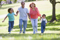 Grandparents running with grandchildren Stock Photos