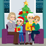 Grandparents Sharing Gifts In Christmas Royalty Free Stock Photos