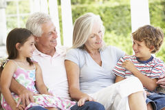 Grandparents Sitting Outisde with Grandchildren Royalty Free Stock Photo