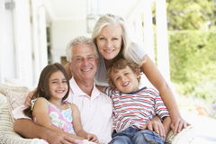 Grandparents Sitting Outisde with Grandchildren Stock Photography