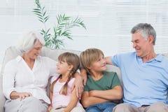 Grandparents speaking with their grandchildren Stock Images