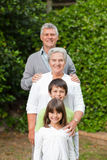Grandparents with their children smiling Stock Photo