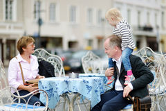 Grandparents and their grandchild in outdoor cafe Stock Photo