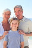 Grandparents with their grandson at the beach Stock Photo