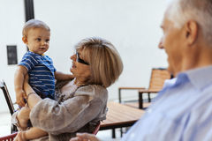 Grandparents With Their Grandson At Cafe Royalty Free Stock Photography