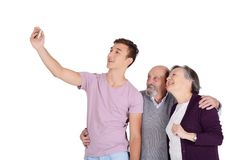 Grandparents and their grandson taking a selfie. Grandparents and their teen grandson taking a selfie. Isolated on white background Stock Image