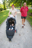 Grandparents Walking Baby in the Park Royalty Free Stock Photography