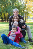 Grandparents walking with grandchildren in autumn park Royalty Free Stock Photography