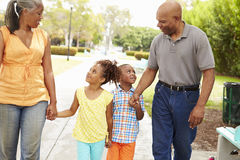 Grandparents Walking Grandchildren In Park Stock Photo