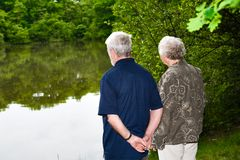 Grandparents watching the lake Stock Photos