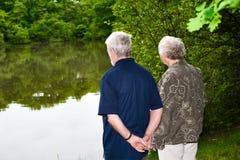 Grandparents watching the lake stock photos