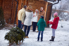 Grandparents welcome the family on Christmas royalty free stock photo