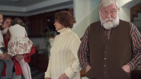 Grandparents were trying to reassure their naughty running granddaughters, but only after their father`s coming they. Stopped stock video footage
