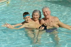 Free Grandparents With Grandson In Swimming Pool Stock Images - 99416934