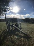 Grandpas farm. Country farm antique equipment blue sky Stock Image
