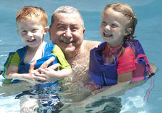 Grandpop and the grand children Royalty Free Stock Photos
