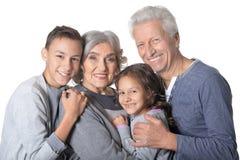 Grands-parents avec le portrait de petits-enfants Photo libre de droits