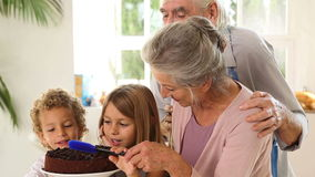 Grands parents and children making chocolate sauce Royalty Free Stock Images