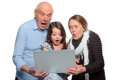 Grands-parents et petite-fille choqués image stock