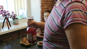 Grandson eats at grandma`s cottage cheese pancakes with honey. stock video footage