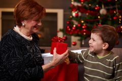 Grandson giving christmas present Stock Photography