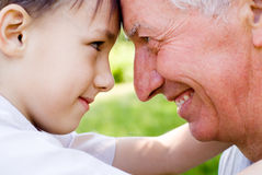 Grandson with grandfather Royalty Free Stock Photo