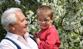 Grandson and grandfather Stock Photos
