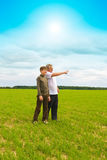 Grandson and  grandfather in  field Royalty Free Stock Photo