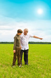 Grandson and  grandfather in  field Royalty Free Stock Photos