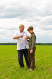 Grandson and  grandfather in  field Stock Photography