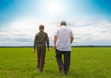 Grandson and  grandfather in  field Stock Images