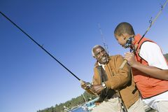 Grandson And Grandfather Fishing Together Stock Photography