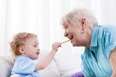 Grandson and grandma eating together Royalty Free Stock Photos