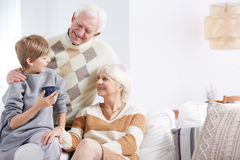 Grandson, grandma and grandpa. Spending time together royalty free stock images